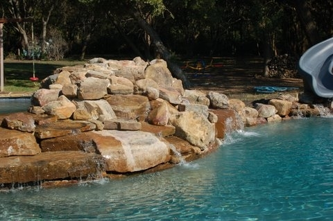 Swimming Pool with Rock Waterfall and Slide