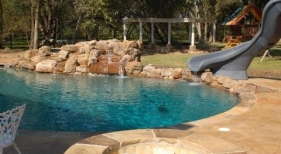 Swimming Pool with Slide and Rock Waterfall